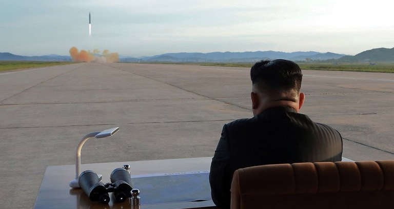 Kim Jong Un watches as a Hwasong-12 missile is launched from Sunan Airport in Pyongyang.